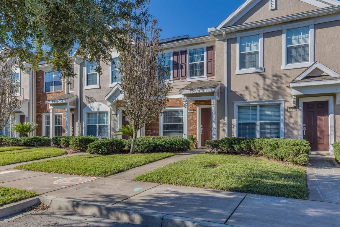 6787 Arching Branch Cr - 125,000 - Who doesn't love the convenience of Bartram Park??? Why spend $160,000 and up on a brand new town home when you can get in one less than 10 years old in this condition and at this price? When you walk in this town home you immediately notice the beautiful kitchen with stainless appliances and tons of cabinet space. The floor plan features an open design and flows right into the dining and living areas.