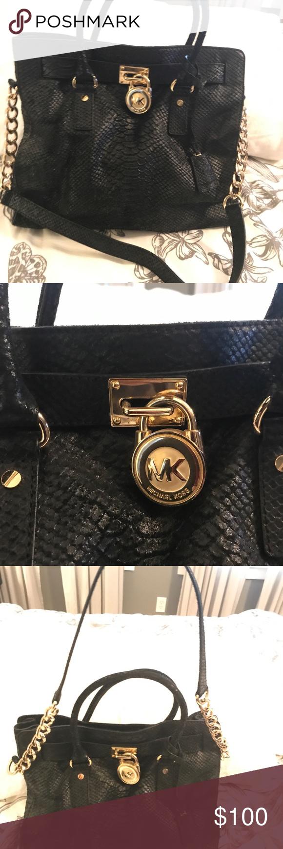 5f12ef9421bd Michael Kors black snake print classic handbag. This bag looks good with  everything! It's a vintage Michael Kors, good condition .