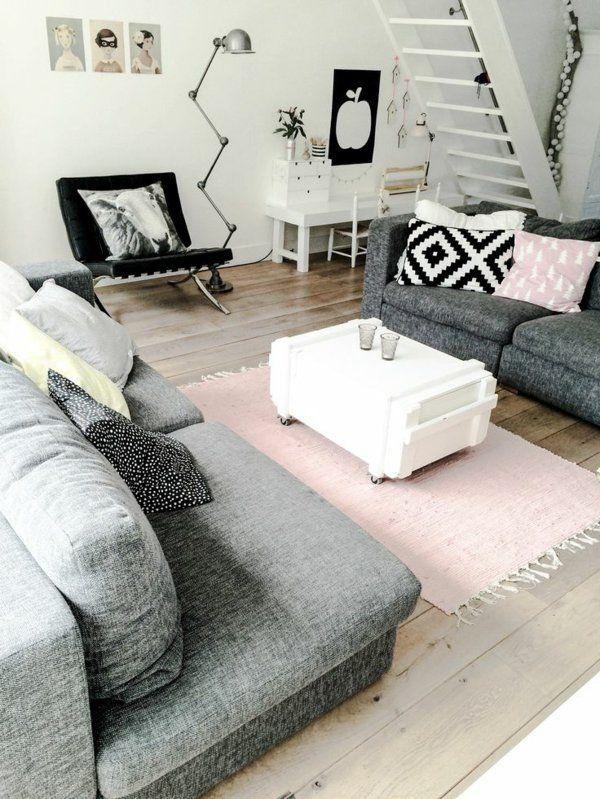 Décoration scandinave salle de séjour spectaculaire tapis rose et sofas gris