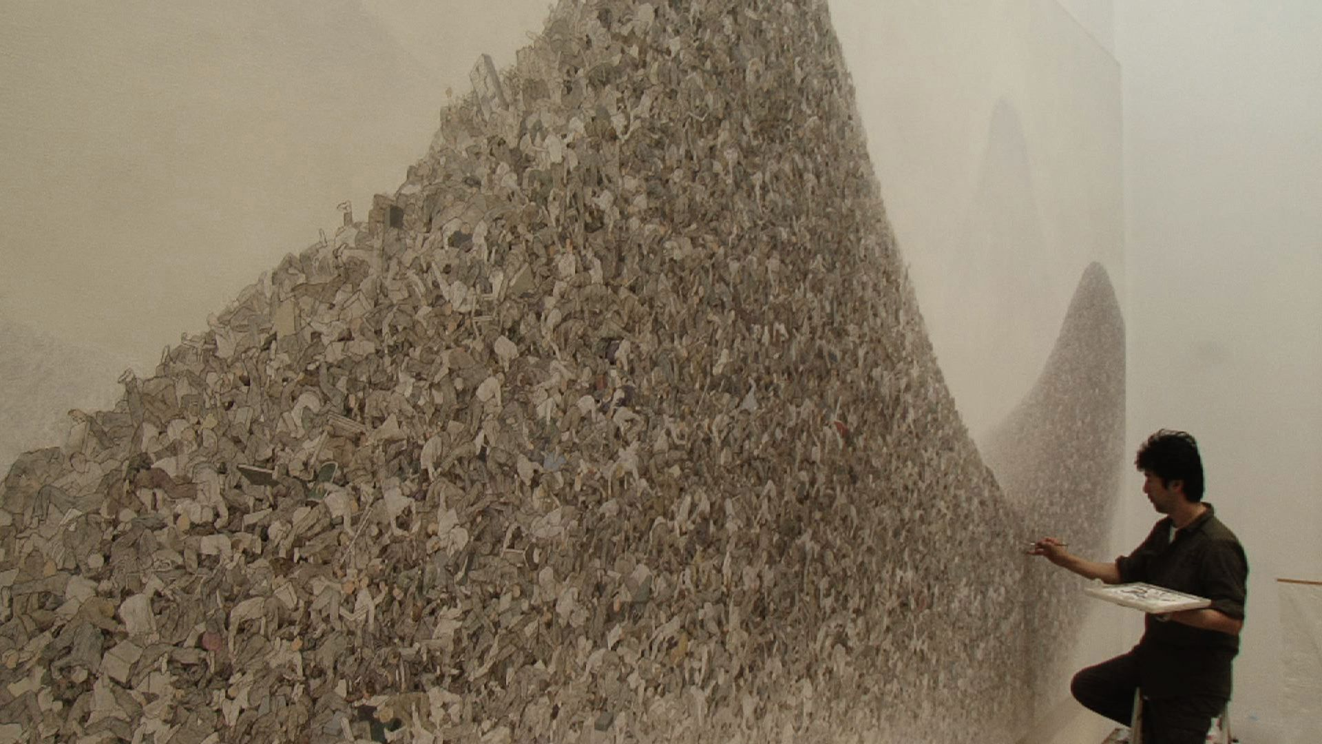 Aida Makoto work in progress is the depiction of a mountain of businessmen's bodies piled high and rising out of the mist.