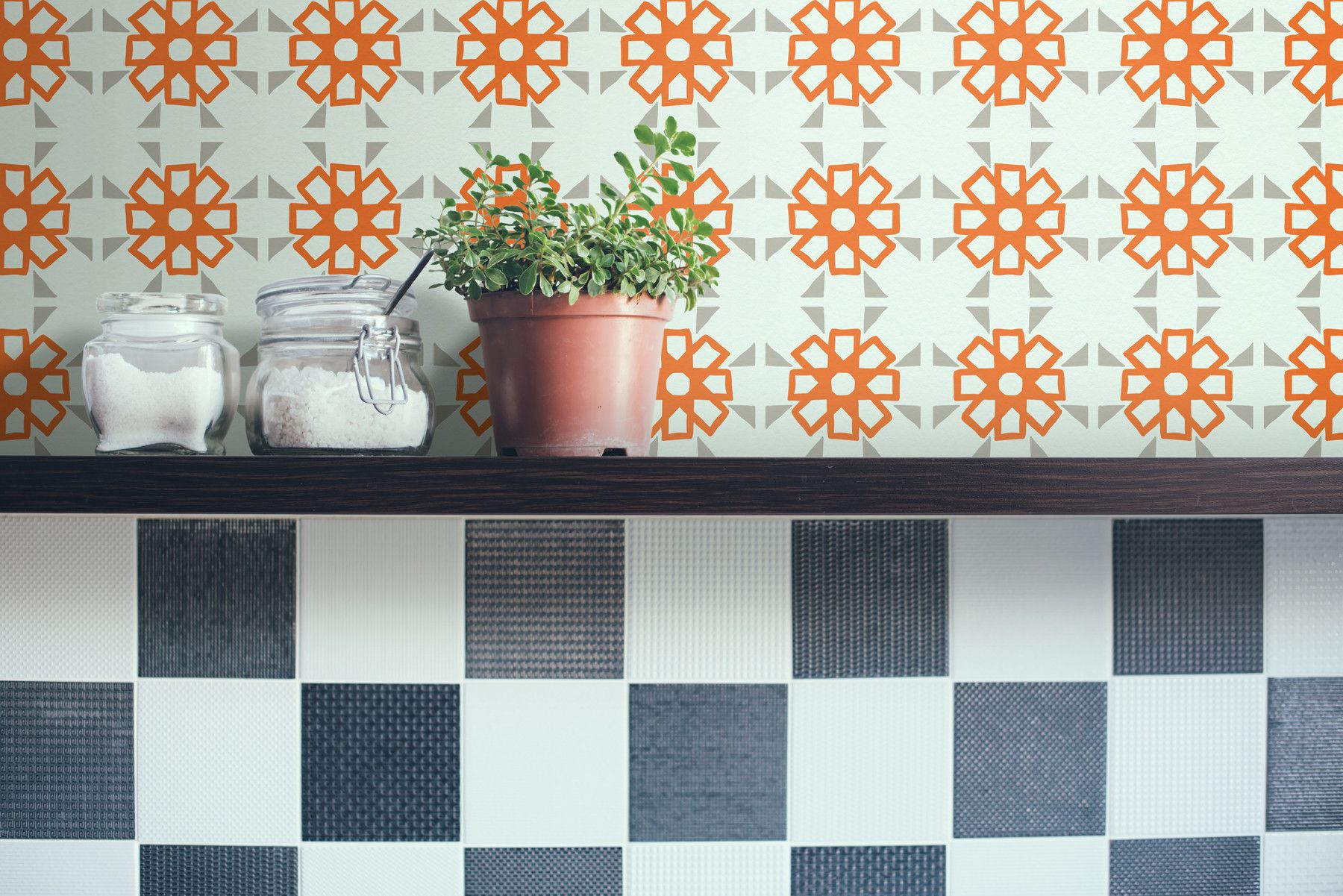 "Stuck somewhere between classic Moroccan floral tile design and your grandma's vinyl tablecloth, Tyles Alhambra in Warm Grey and Orange just seems to say ""welcome home."""