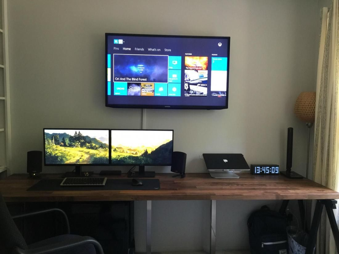 Dual monitors on wooden desk with wall mounted tv 10 for Tv wall setup ideas