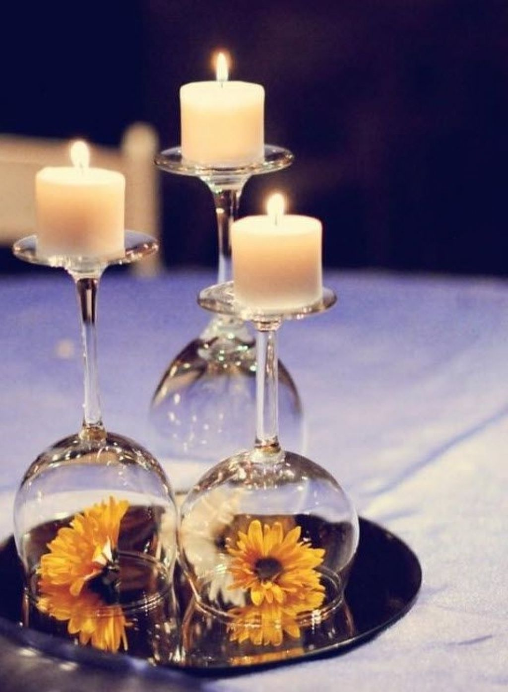 12 wedding centerpiece ideas from pinterest wine glass for Cheap and easy wedding decorations