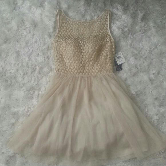 Cream and gold dress. Also sold as a set. Such a pretty feminine gorgeous dress with puffy flare to it on the bottom. Gold detailing on the top and bottom is made of a soft tool. Dresses