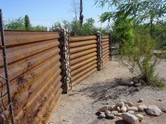 Love This Naturally Rusting Western Rib Corrugated Sheet Metal With Rebar Stone Posts Rustic Garden Fence Corrugated Metal Fence Fence Landscaping