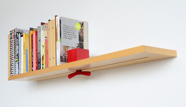 Colleen Whiteley's Hold On Tight Shelf ... a bright, over-sized wing nut serves as a bookend, which slides into place and can be adjusted and secured wherever it is needed.