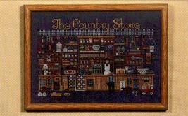 The Country Store amish cross stitch chart Told In A Garden - $9.00