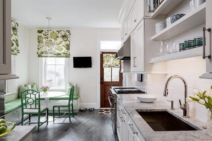 Green And White Kitchen Nook Features An L Shaped Dining Banquette Topped  With A Green