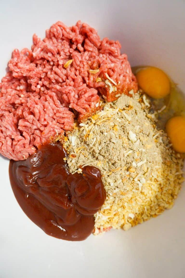 Raw Ground Beef Ritz Cracker Crumbs Bbq Sauce And Eggs In A Mixing Bowl In 2020 Meatloaf Casserole Cheesy Tater Tots Beef Recipes For Dinner