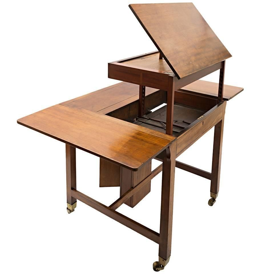 English mahogany architect table with drop leaves and brass mounts and brass handle it has a very unusual pulley and weight system enclosure which