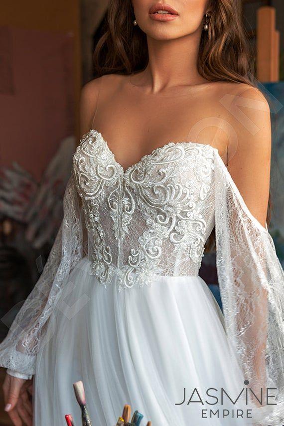 Photo of Individual size A-line silhouette Roxana wedding dress. Mode…