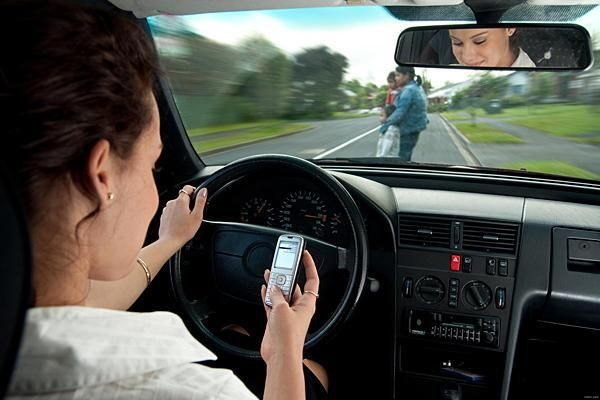 Image result for images of using cellphone while driving