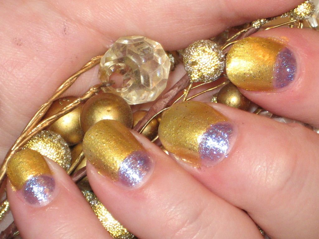 gold and purple painted nails