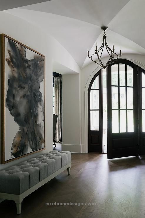 Unbelievable  black arched front door complemented with sidelights provides bit of drama to chic foyer lit by quatrefoil light pendant and also bring portion the world your piede terre high end rh pinterest
