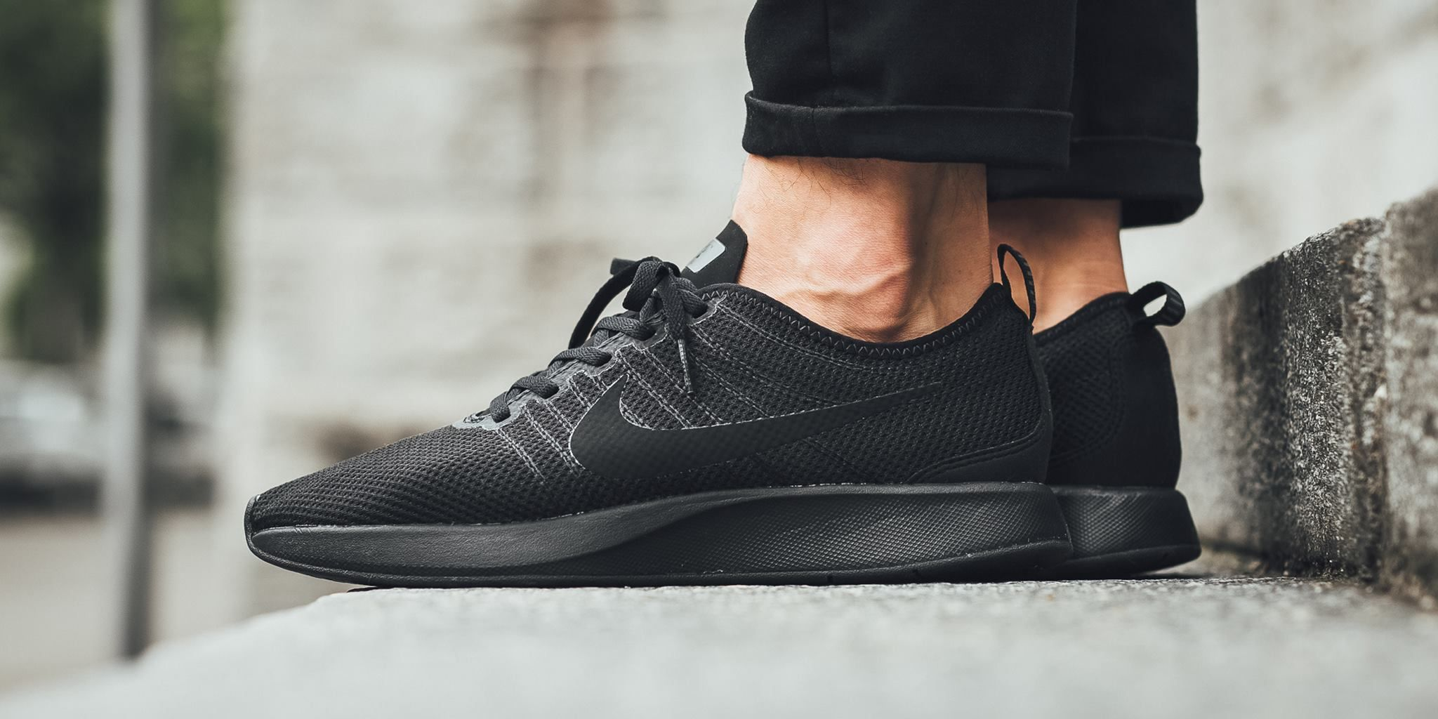585600fd61c0 The Nike Dualtone Racer is featured in a new triple black colorway for Fall  2017.