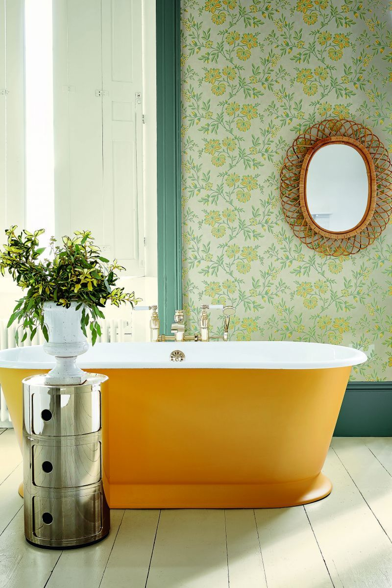 Shown here, Drummonds' imposing cast iron 'Humber' bath has been hand painted in Little Greene's 'Mister David 47'.  The vibrant saffron shade confirms it as the design focus of the room and cues the colour palette for the walls and woodwork drummonds-uk.com