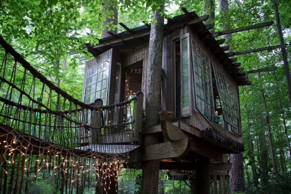 Satisfy childhood dreams with this forest fantasy in Atlanta, Georgia, which is one of the most popular Airbnb rentals of all time. The bedroom, living room, and deck all connected by swinging rope bridges. Click through to rent this space or to see more of the best treehouses and treehouse vacation spots.