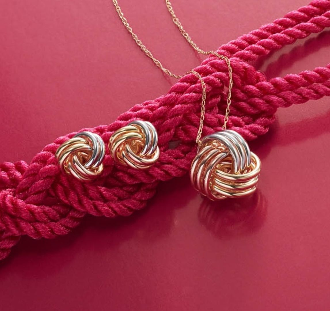 Yellow White And Rose Gold Intertwine To Create The Symbol Of Never