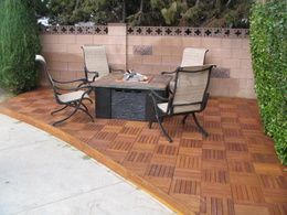 Convert A Patio To Wood Deck In A Jiff. These Wooden Tiles Snap Together.  We Actually Use These For Our Shower Floor.
