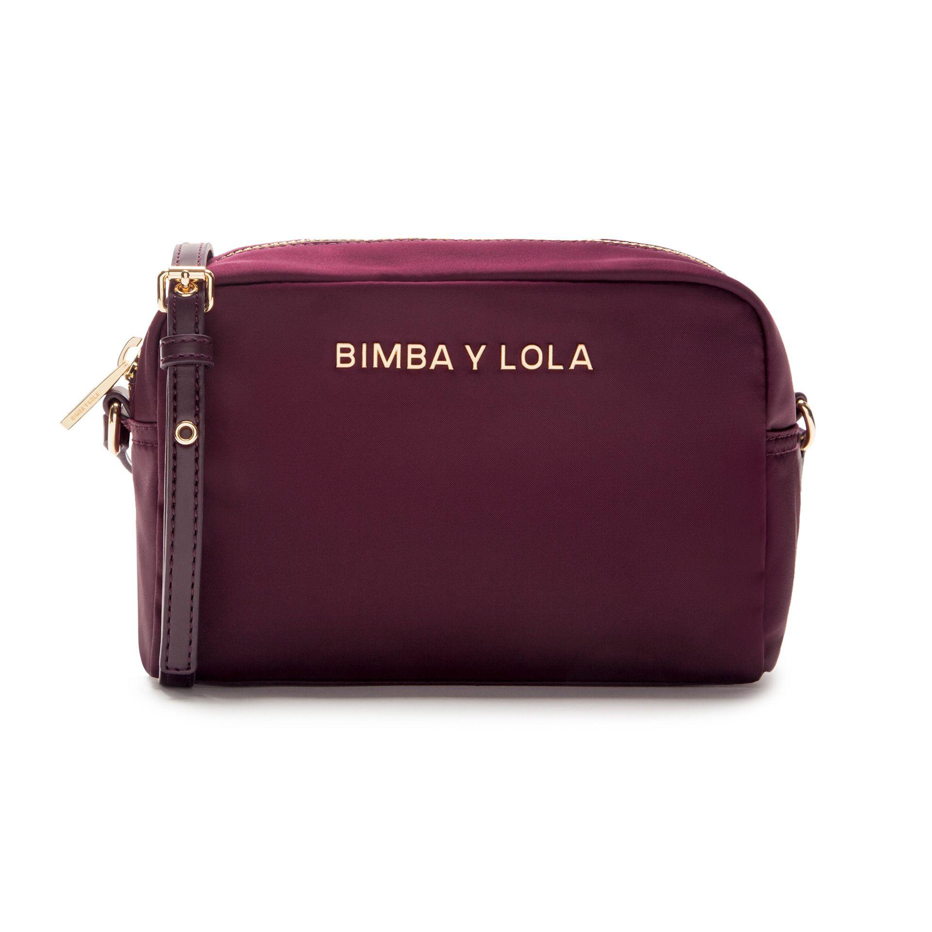 d2bd090310371 Bolso bandolera rectangular BIMBA Y LOLA en color vino. Pertenece a la  Olympia Collection