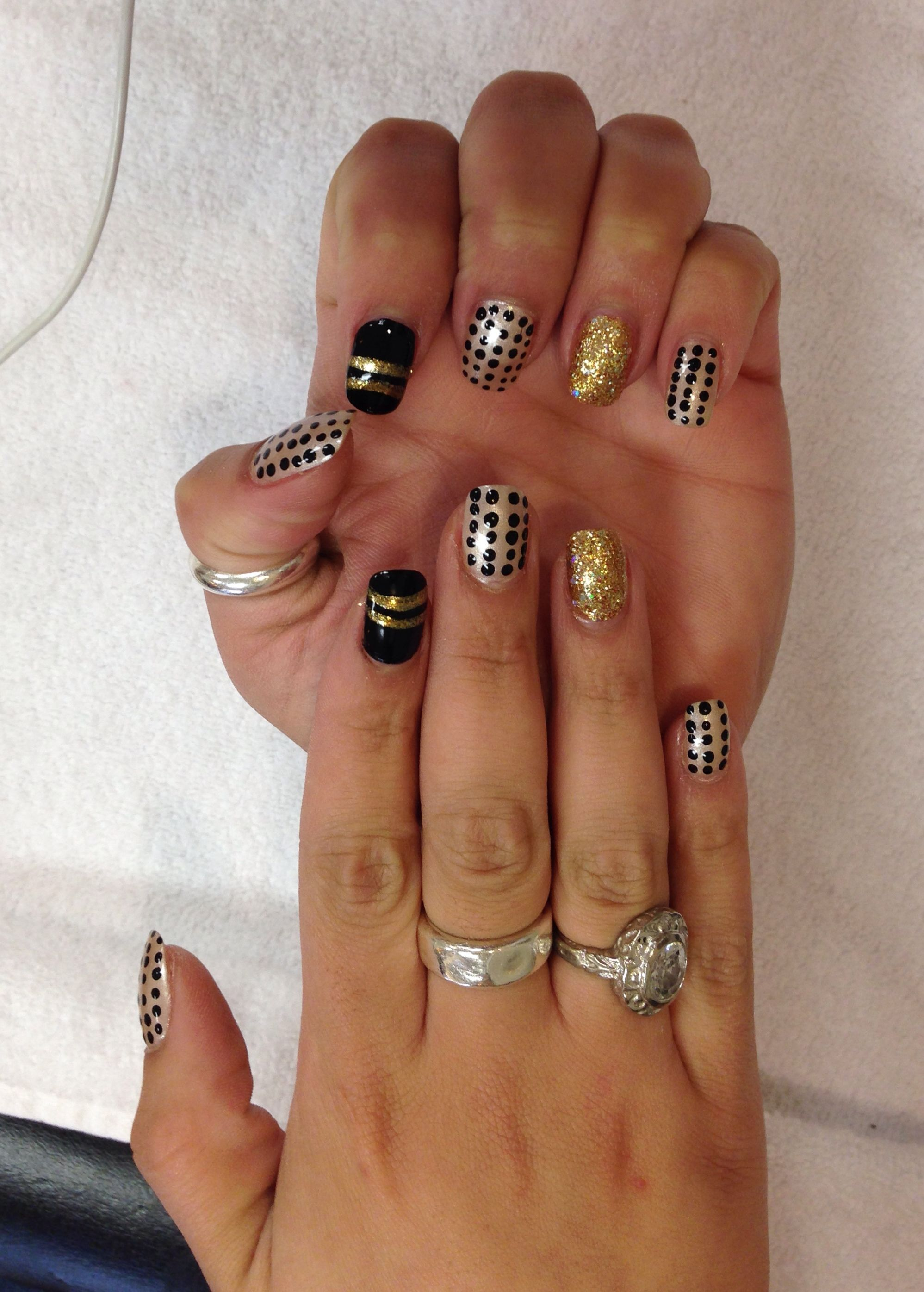 Bad A$$ black & gold design on my acrylic over-laid nails...I am soooo loving my nails right now!!!!