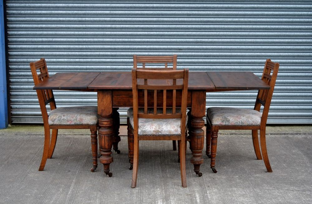 Victorian Drawer Leaf Antique Dining Table And 4 Oak Chairs With Caster  Wheels.