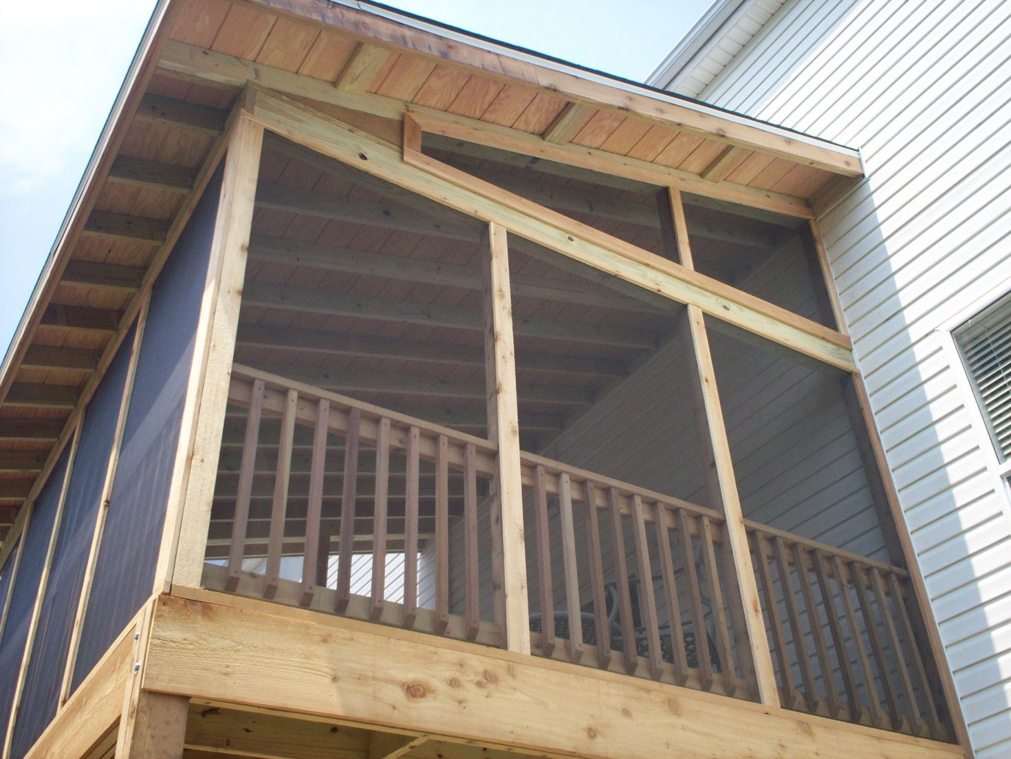 Screen porch with exposed rafter ceiling and shed roof st Shed with screened porch