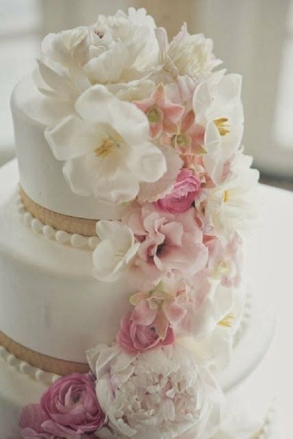 White wedding cake with pale pink flowers