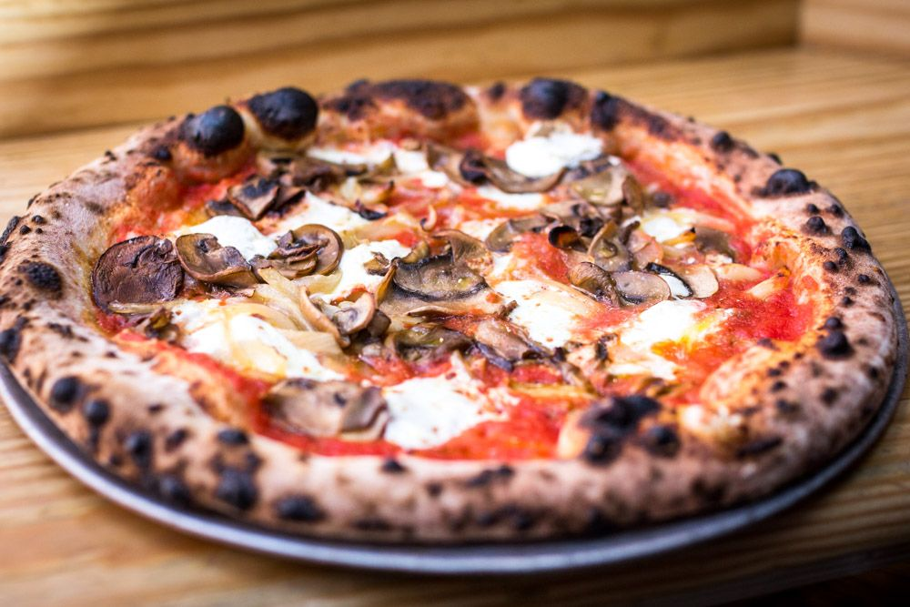 San Marzano Tomato, Fresh Mozzarella, Ricotta, Roasted Garlic, Peppers, Onion, Mushrooms.