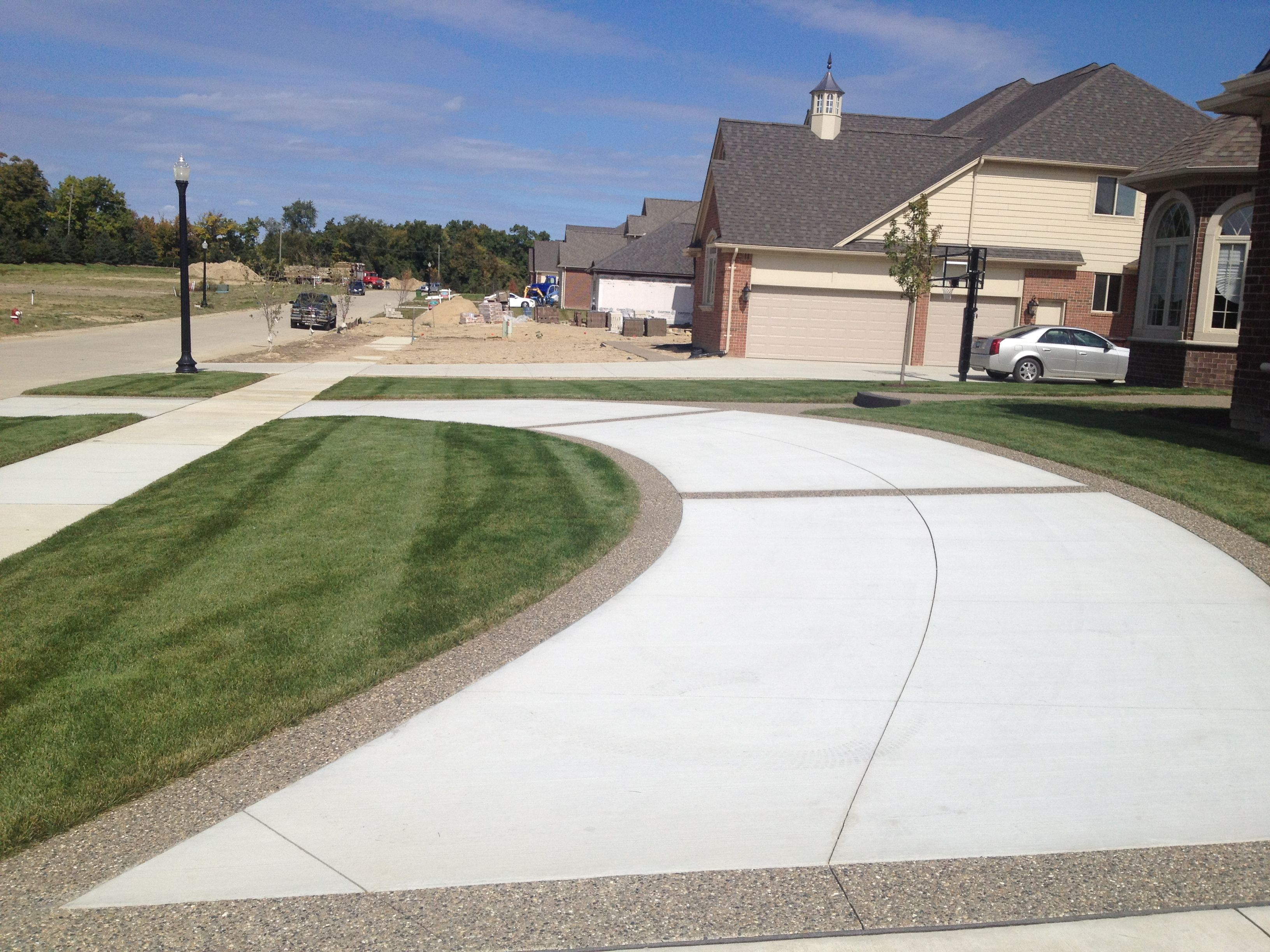 Driveway With Exposed Aggregate Border Front Yard Patio Driveway Design Stamped Concrete Driveway