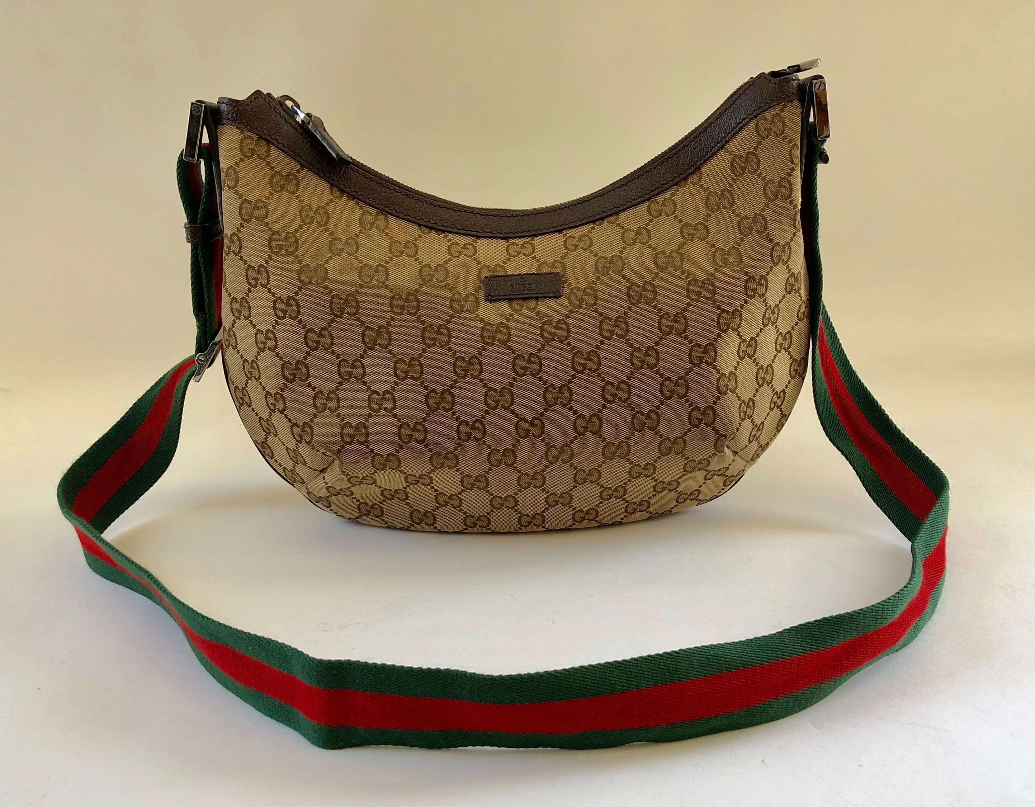 d07aa5aca36 Authentic Gucci brown GG woven canvas zippered cross body shoulder bag with  ribbon strap. Very