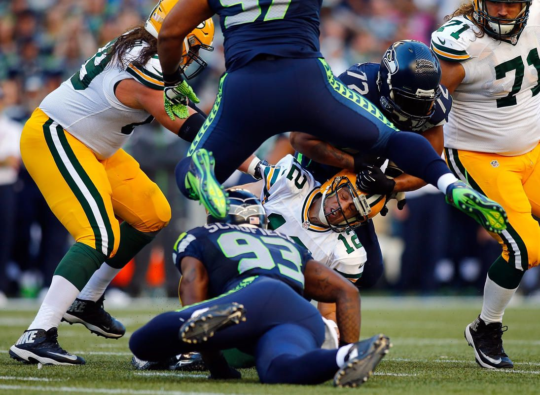 2014 Nfl Kickoff Packers Vs Seahawks Quarterback Aaron Rodgers 12 Of The Green Bay Packers Is Tackled By Defensive End O Br Nfl Seahawks Seattle Seahawks