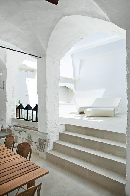 Italian designers Ludovica+Roberto Palomba carve a serene retreat out of a 17th-century oil mill in Salento