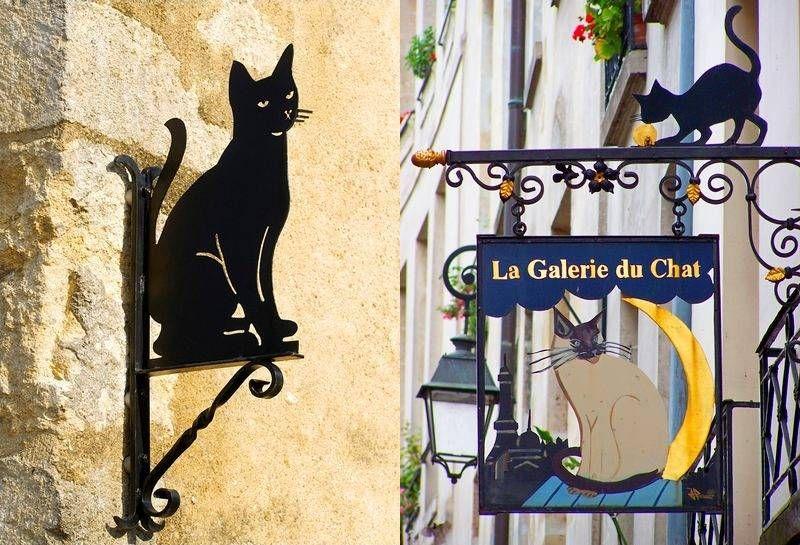 gatos se equilibram no alto de letreiros retr de metal. Black Bedroom Furniture Sets. Home Design Ideas