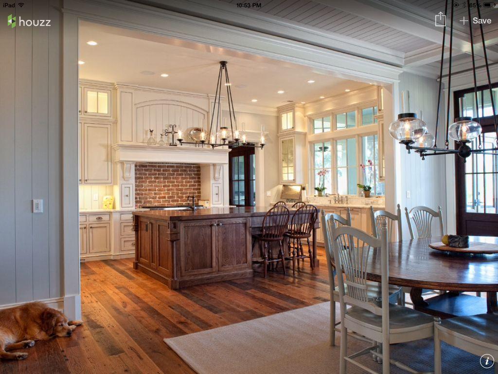 Pretty kitchen. Like the brick accent.