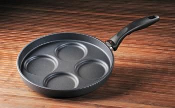 Swiss Diamond Plett Pan (Silver Dollar Pancake Pan) - Made for swedish pancakes, perfectly round eggs, silver dollar pancakes, hamburger sliders and more. No sticking, no burning - just use medium heat. The non-stick coating is reinforced with real diamond crystals. The balanced, ergonomic handle stays cool on the stovetop. The perfectly flat base distributes heat evenly and will not tip or spin. Simply wash with hot soapy water, no more scrubbing or soaking. $149.99