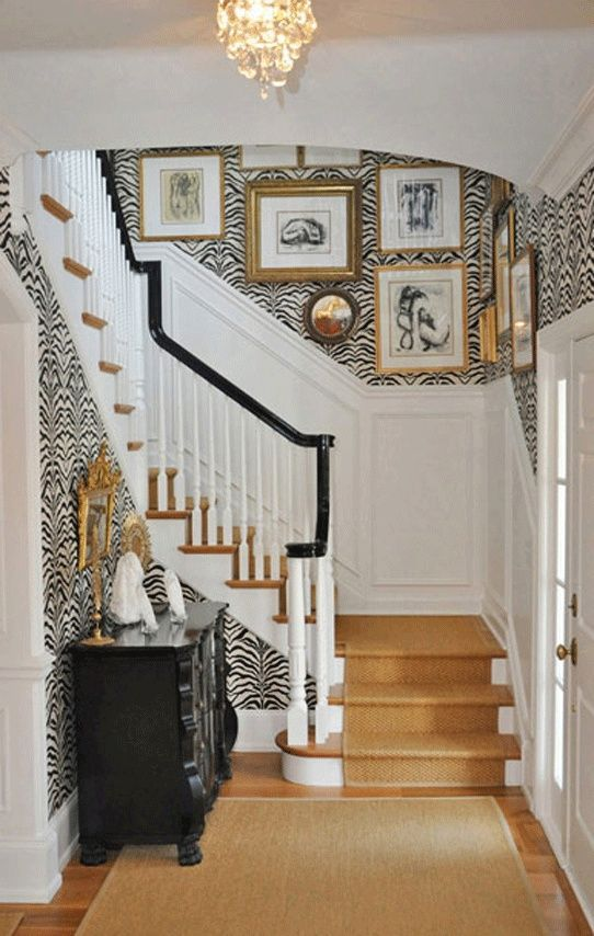 Wainscoting At The Bottom With A Fun Zebra Print Wallpaper On Top
