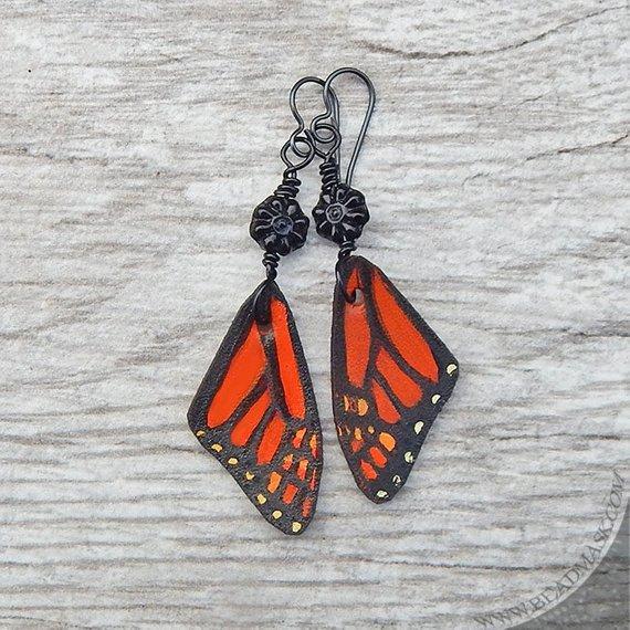 Monarch butterfly leather earrings. Orange and black dangle earrings w/ glass flowers and niobium ho