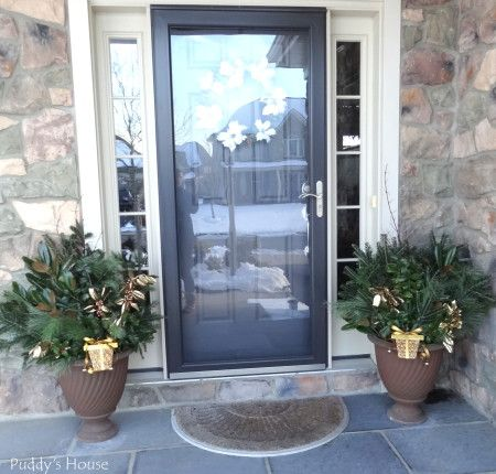 Fresh greenery in urns and DIY wreath on door - Puddy's House
