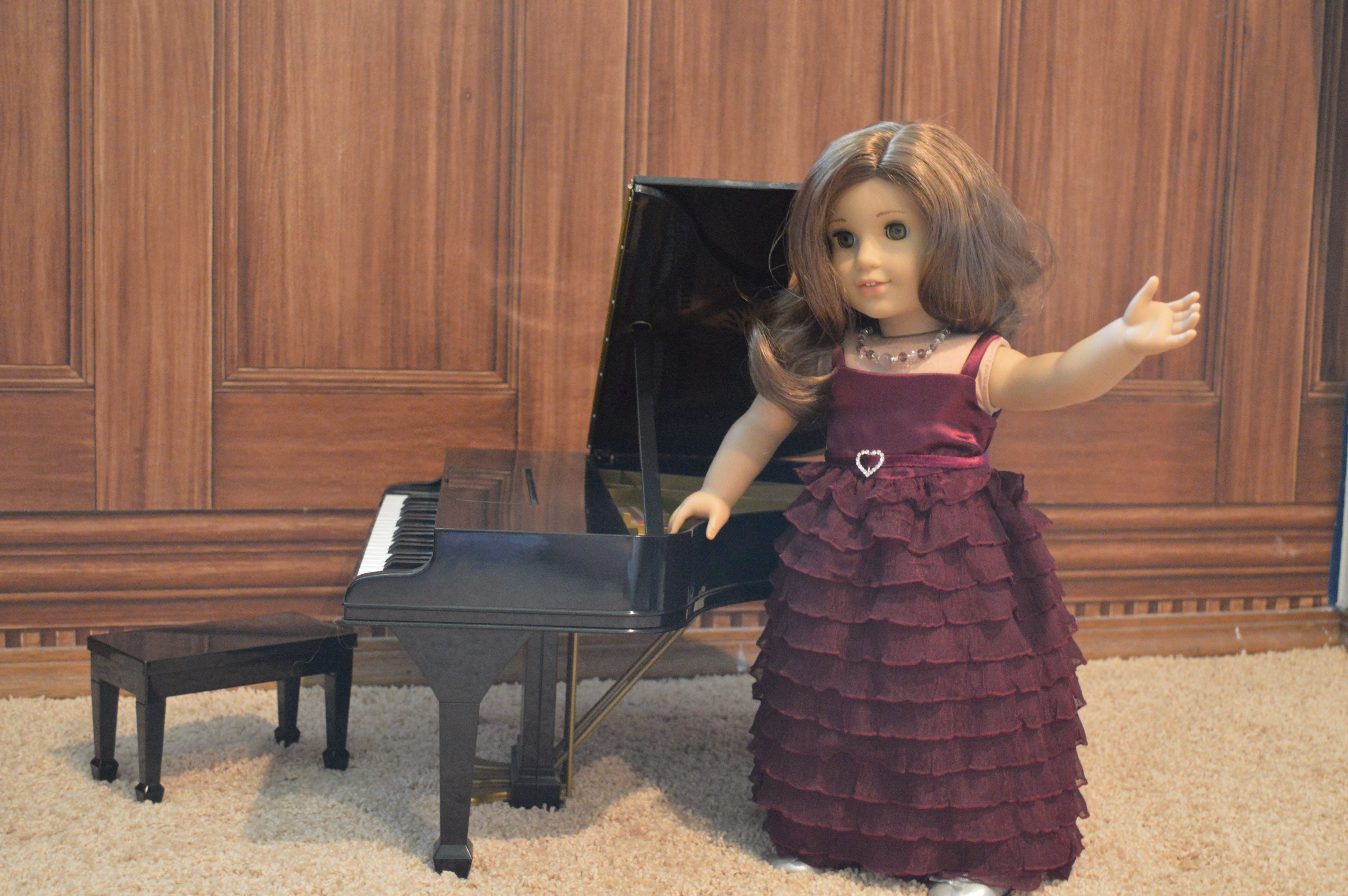 Miss rebecca performs at her voice recital in the cascading magenta