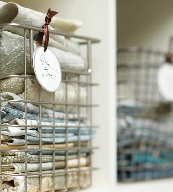 Labeled wire baskets keep fabric samples organized and accessible - gotta do this