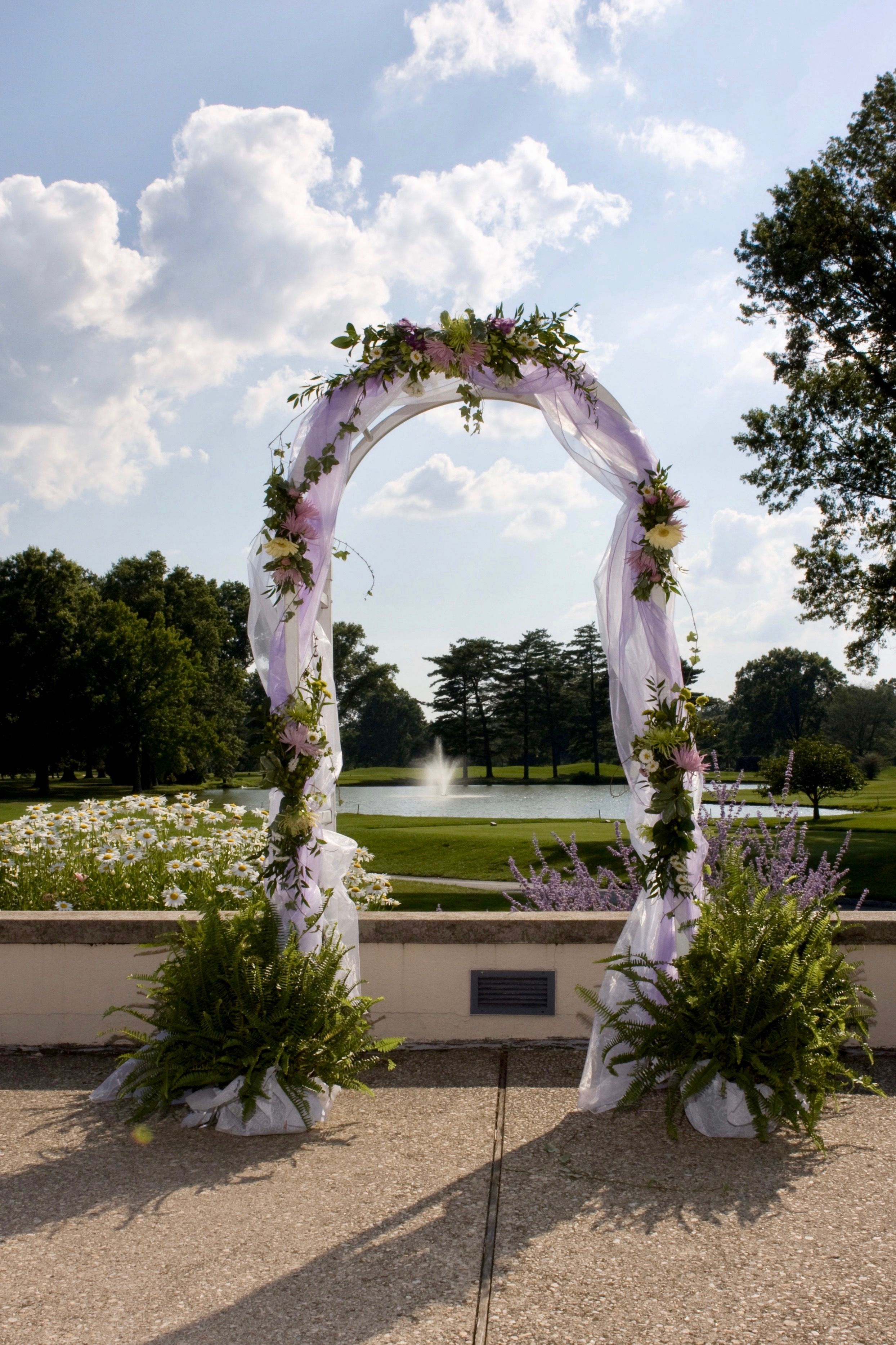An attractive arch is the perfect backdrop for an outdoor ...