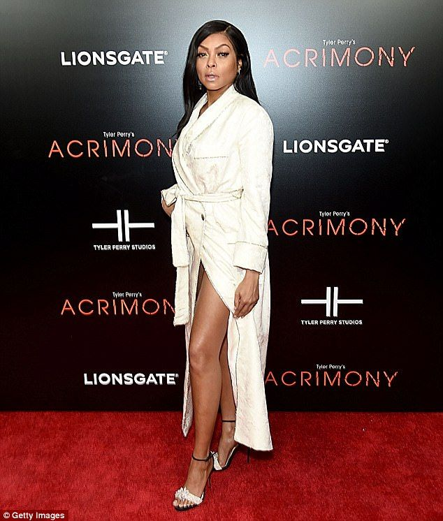 Impressive: Daring to impress, the Proud Mary stunner allowed her ample cleavage to take center stage as the white satin robe had a plunging neckline