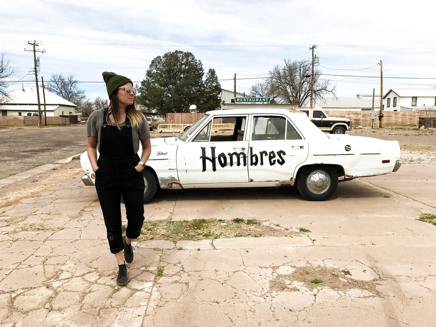Brandi Lisenbe camp style in Marfa, Texas.    Overalls, Cobra Rock Boots, and a Beanie.    Read about #buenosjourneywest at iheartbueno.com
