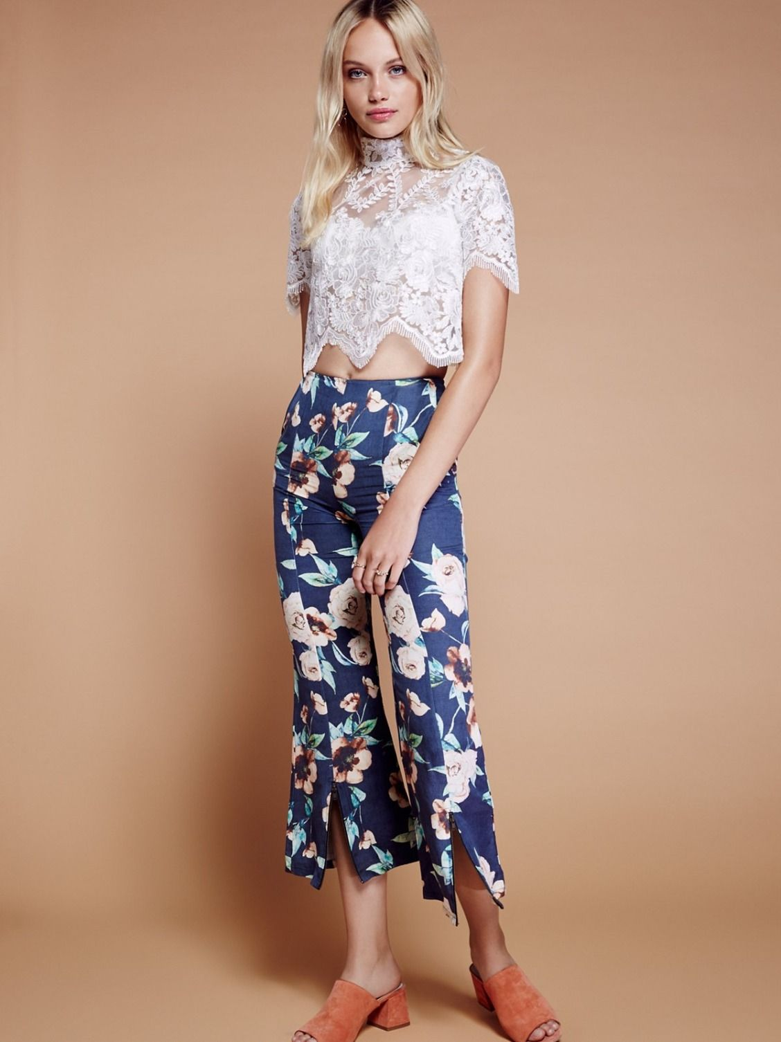 Lily Set | Perfectly mixed set featuring a sheer top and retro-inspired cropped bells. Top has an elegant mock neck with a sweetly scalloped hem and a romantic floral design. Floral pants have a high-waist fit with zipped vents along the front hem. Side pockets. Back zipper closure on both pieces.
