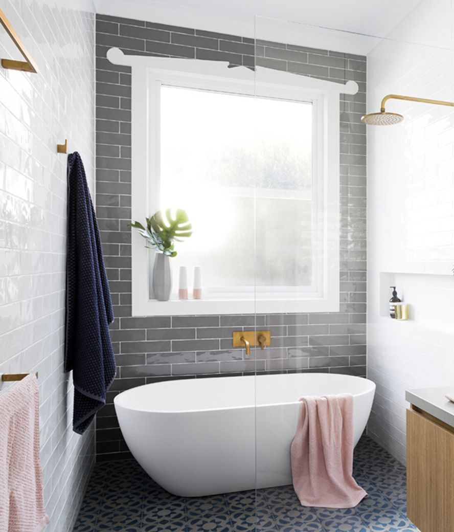 Stand alone tub inside walk in shower with grey tiled statement wall ...