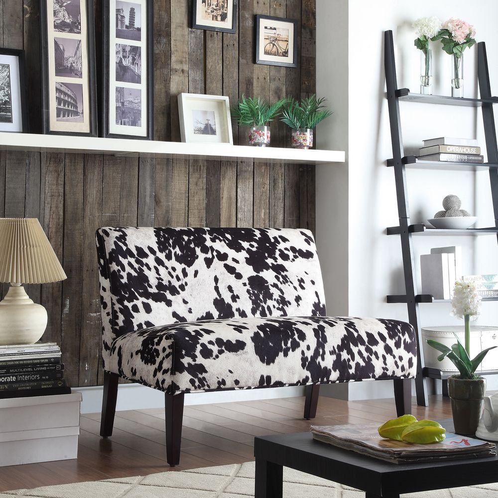 Designed with a durable wood frame, this sophisticated loveseat features a  black-and-white, cow-hide print with an espresso ...