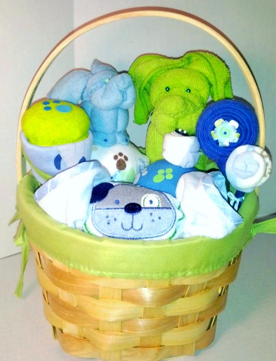 3670ad276629 Boy gift basket with onesie cupcakes