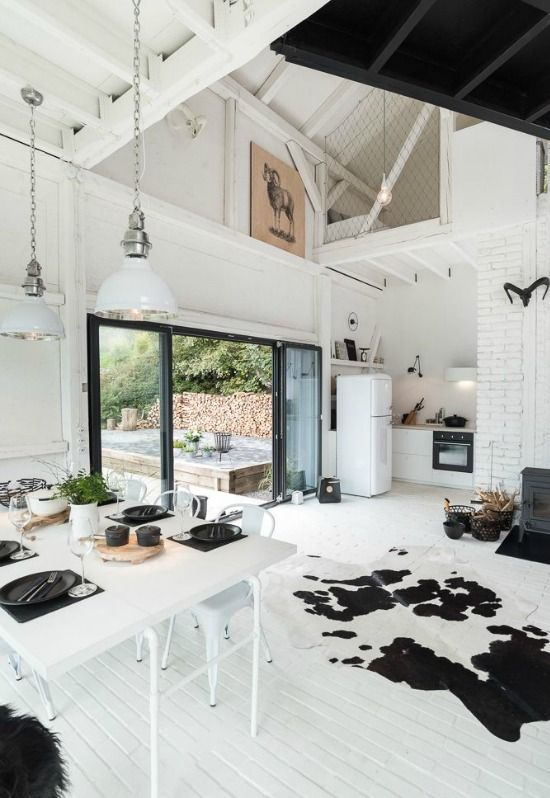 Scandinavian look with glass doors and large windows mixed industrial elements also stylish converted wooden barn home house interior rh pinterest