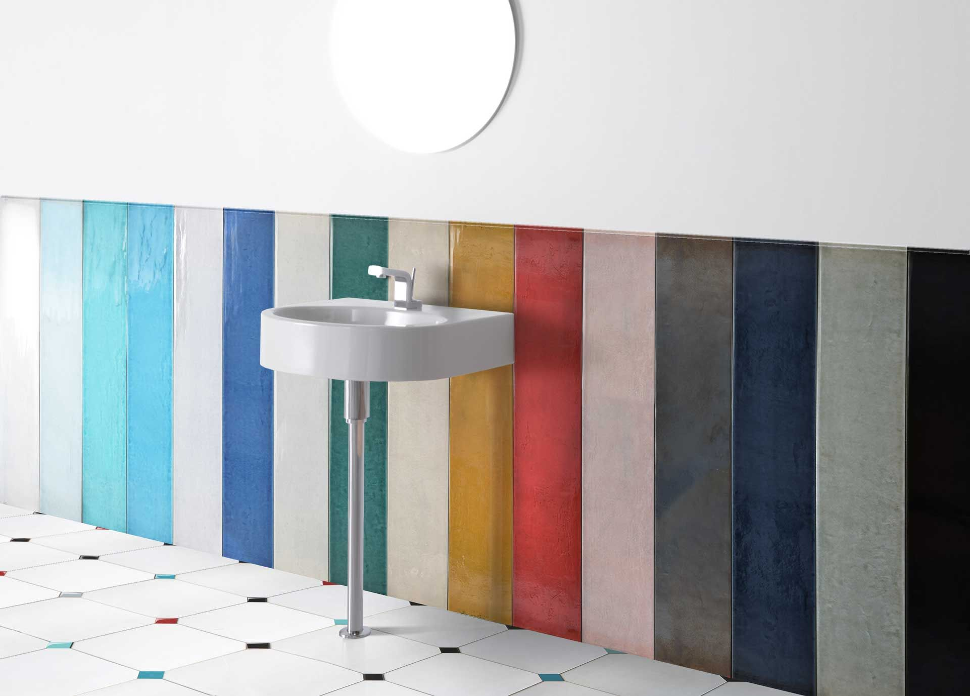 """STICK collection represents a milestone for the technological and artistic research of Ceramica Senio. The crackle glazes are applied on a big sized – 20×120 cm – porcelain tile with surprising aesthetic and ceramic effects. The surface is available in 15 different glossy colours with """"wet"""" effect and opaque metal. The collection is enriched by sub-sizes, mosaics and special pieces.  #stick #ceramic #madeinitaly #ceramicasenio #colour #ceramiclove #homedecor #bathroom #tiles"""